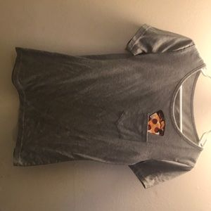 A gray t-shirt with pocket